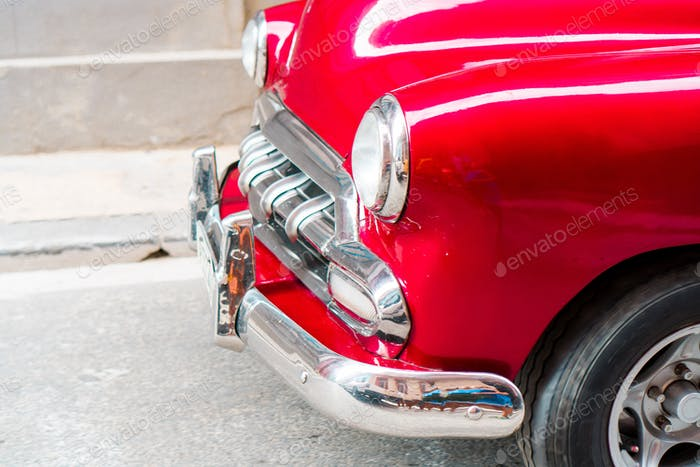 Closeup of red classic vintage car in Old Havana, Cuba
