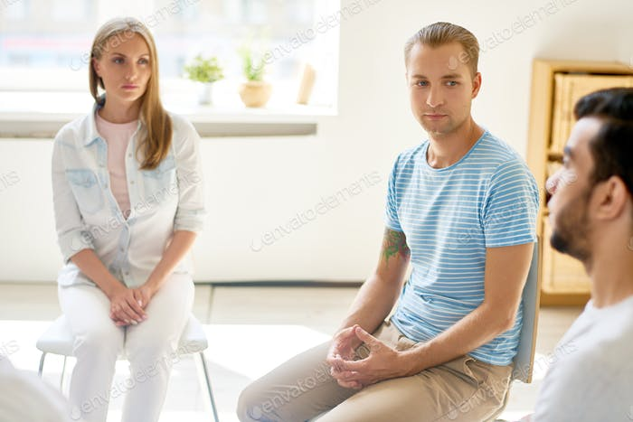 Young Man in  Circle of Support Group