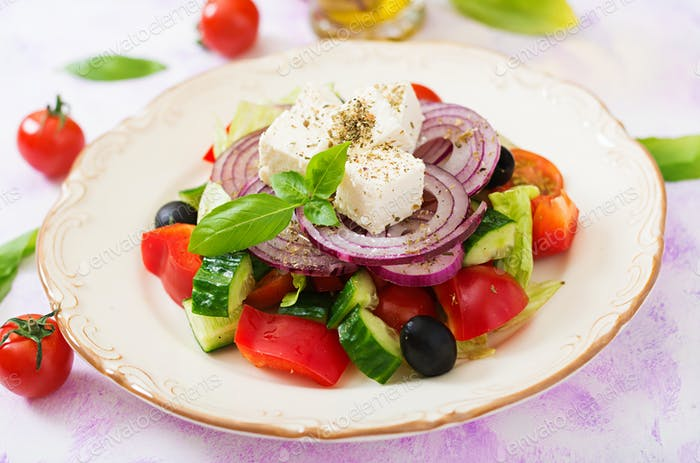 Greek salad with fresh tomato, cucumber, red onion, basil, lettuce, feta cheese, black olives