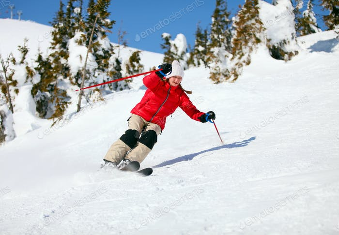 Girl skier moving down the slope