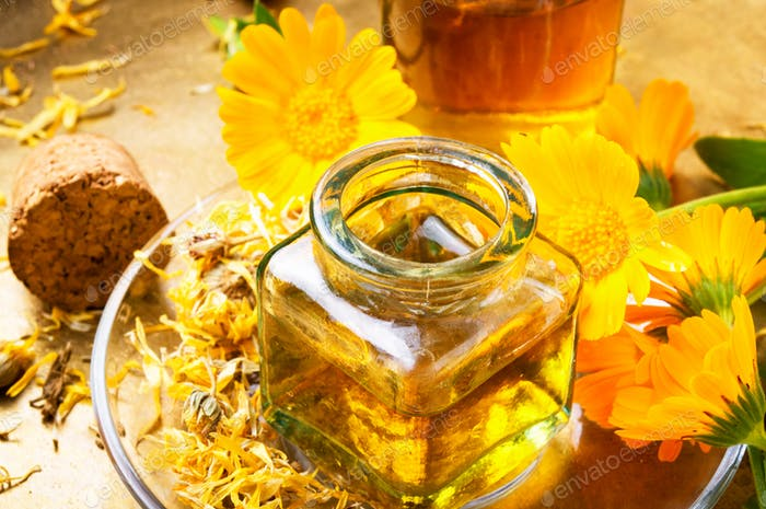 Medicine bottle and herbs calendula