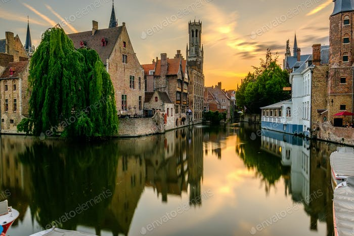 Bruges (Brugge) cityscape with water canal at sunset