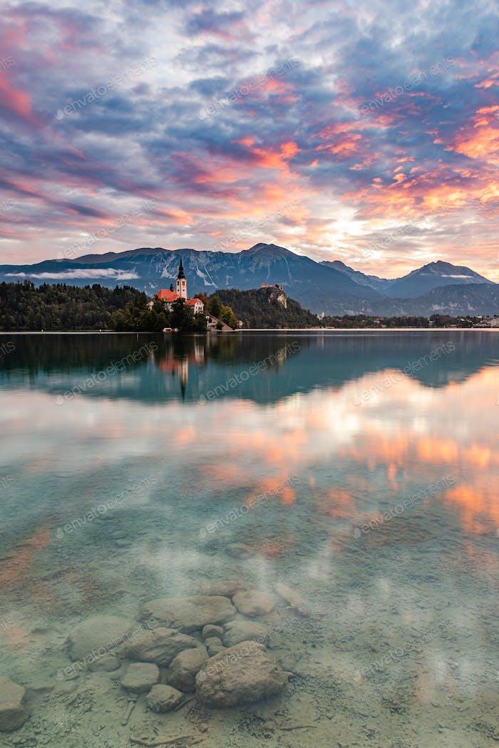 Lake Bled SLovenia and Island Church. Beautiful Sunrise and Wate