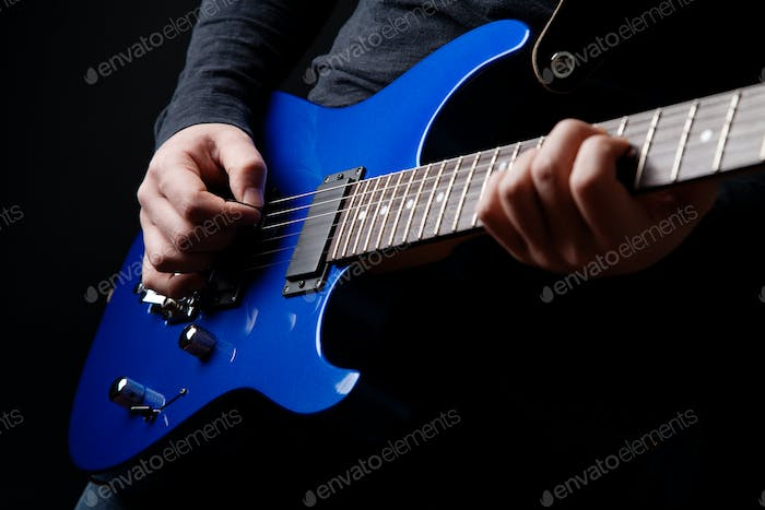 musician rock guitarist playing a blue guitar