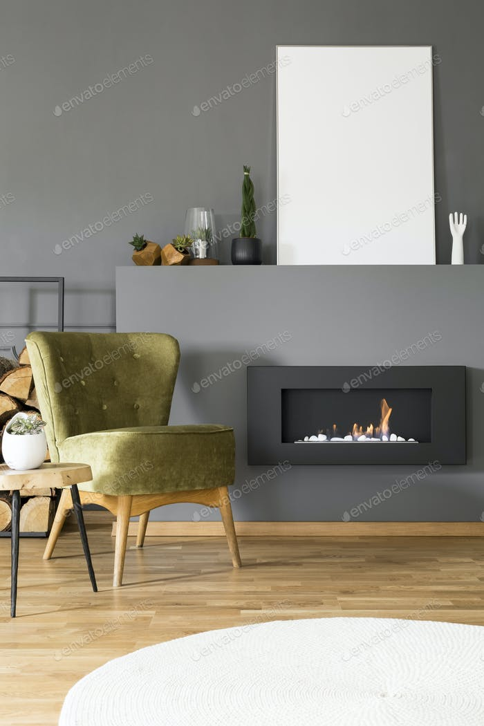 Mockup of white empty poster above fireplace in grey flat interi