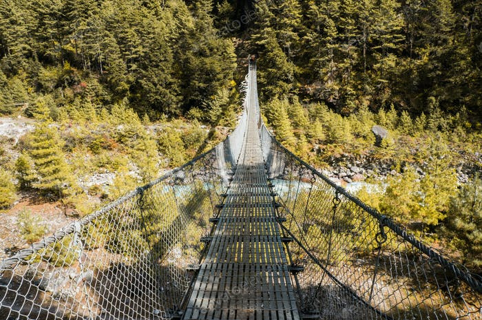 Hanging Bridge Over Mountain River and Green Forest, Nepal, Sagarmatha Zone