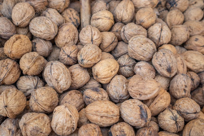 Whole walnuts with shell background, texture. Closeup view