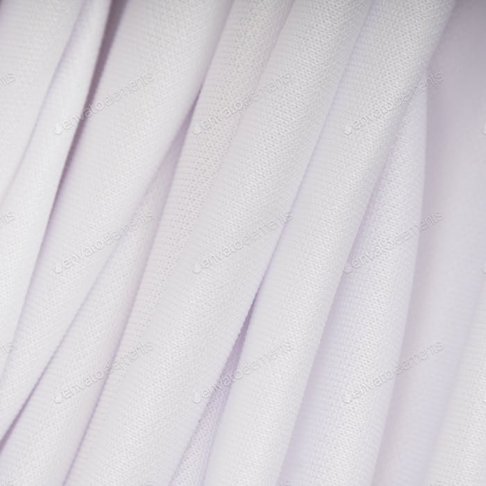 White cloth with pink shade in the folds