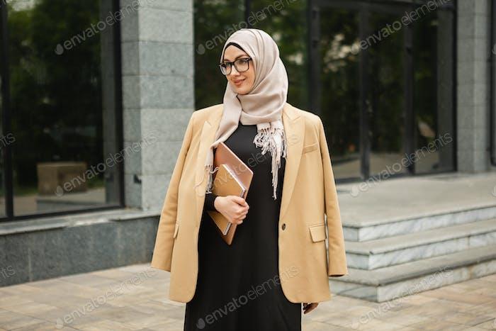 muslim woman in hijab in city street
