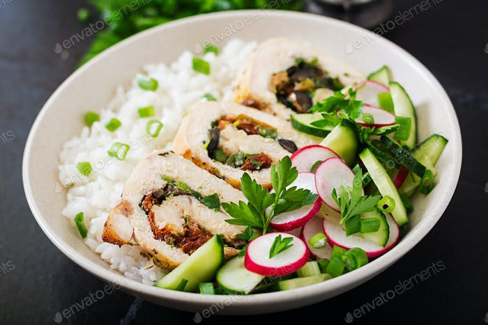 Healthy salad with chicken rolls, radishes, cucumber, green onion and rice.
