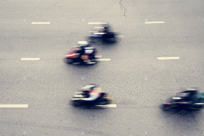 Aerial view of blurred motorbikes on the street in downtown