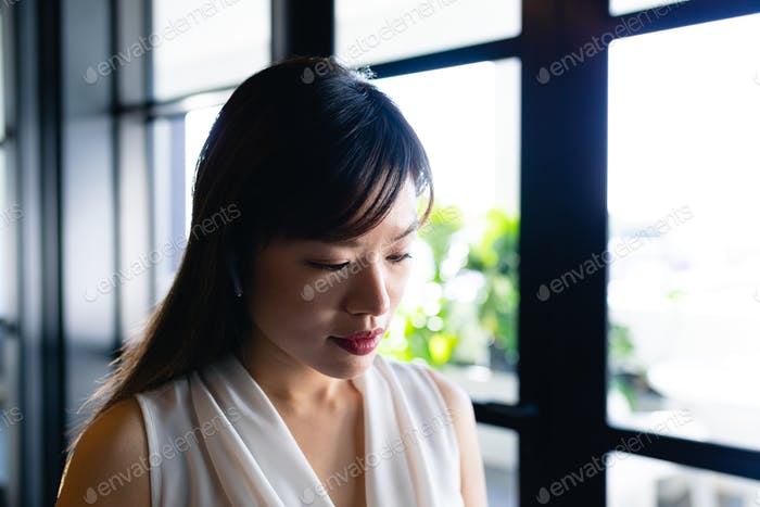 Asian woman looking down