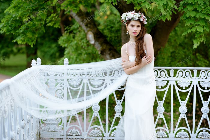 Brunette bride in fashion white wedding dress with makeup