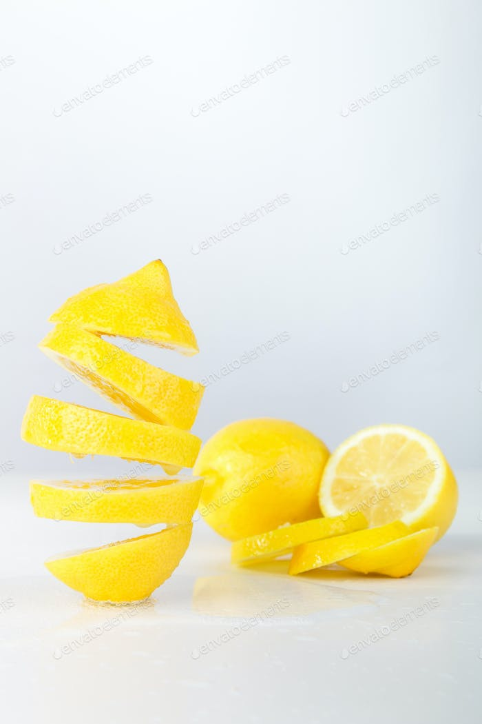 Flying lemon. Sliced lemon