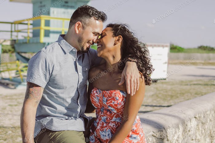 Happy multiracial couple on seafront