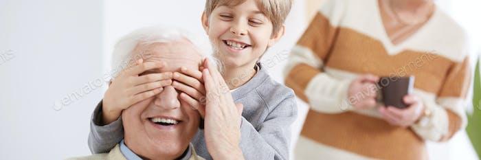 Boy playing with grandpa