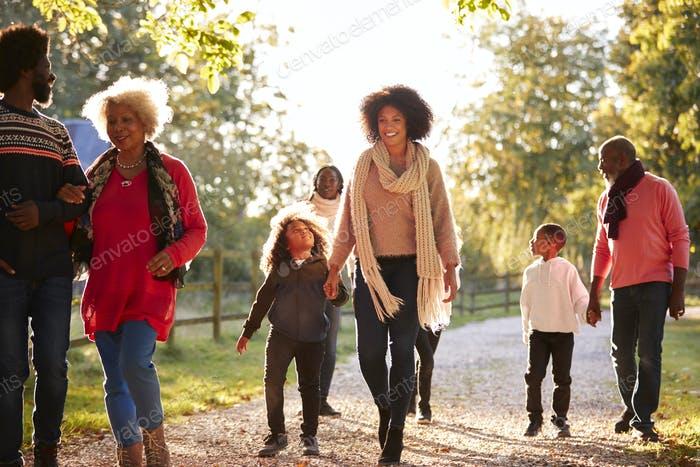Multi Generation Family On Autumn Walk In Countryside Together