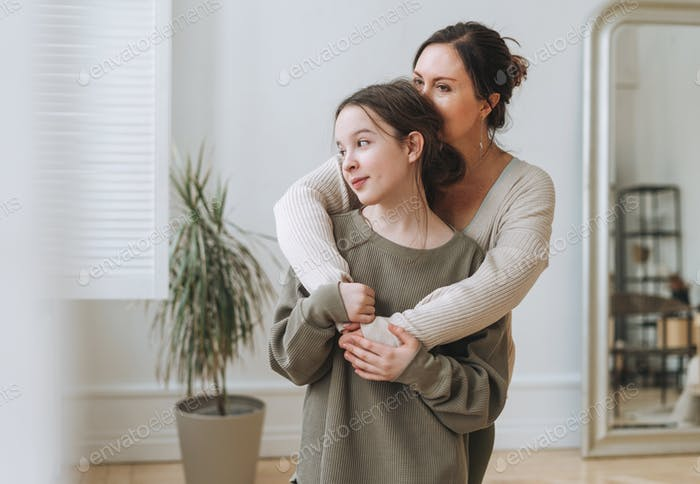 Attractive mother middle age woman and daughter teenager together