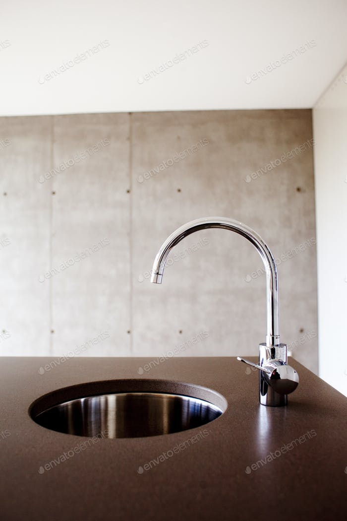 Sink and faucet in kitchen