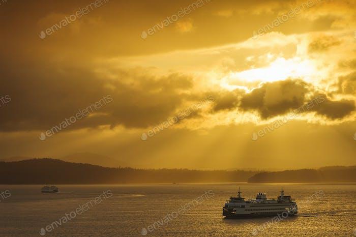 Ferry on ocean water under dramatic sky