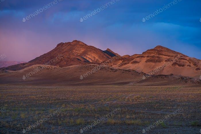 Sunset in Sahara desert.