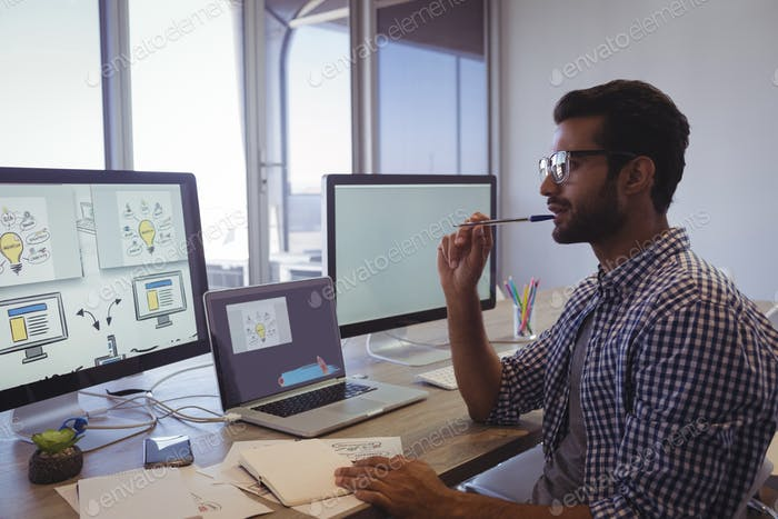 Thoughtful businessman working at office