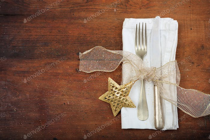Christmas table setting on wooden background