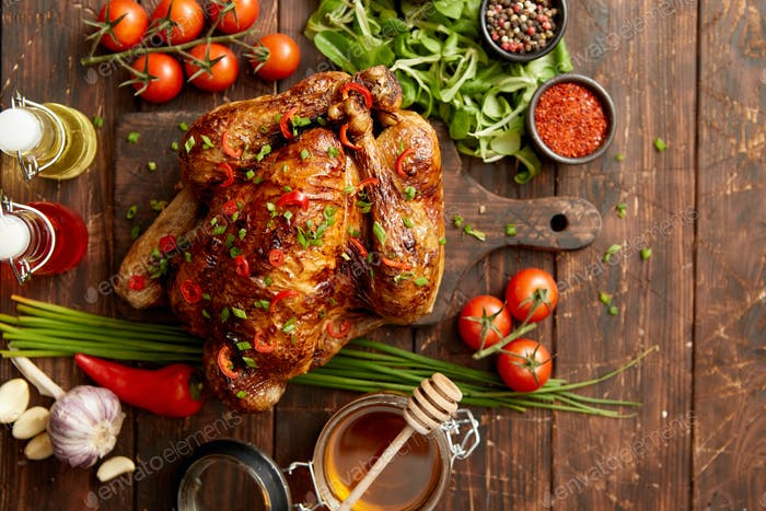 Roasted whole chicken or turkey served with chilli pepers and chive