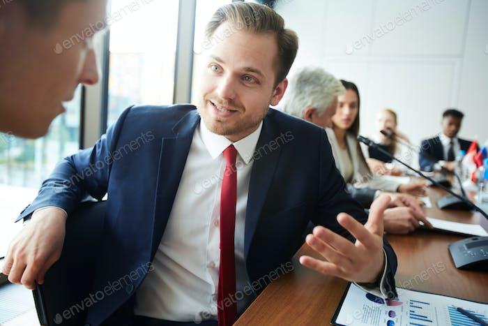 Businessman Communicating at Meeting