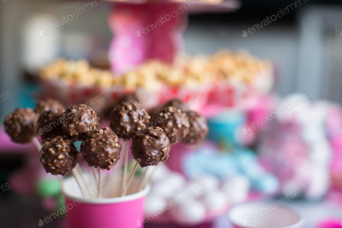 Tasty cakepops on holiday dessert table at kid birthday party
