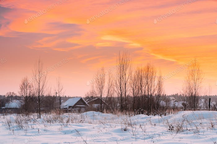 Wooden Houses At Winter Sunset Dawn Sunrise Time