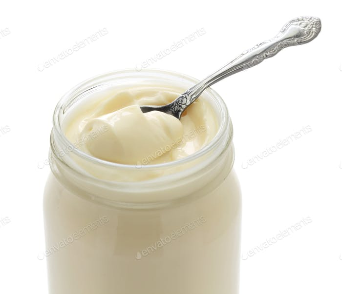 opened mayonnaise jar and spoon