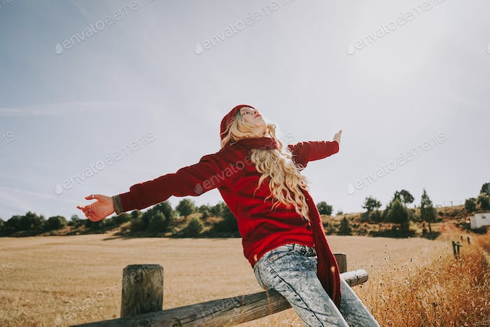 Happy young woman enjoying a sunny day
