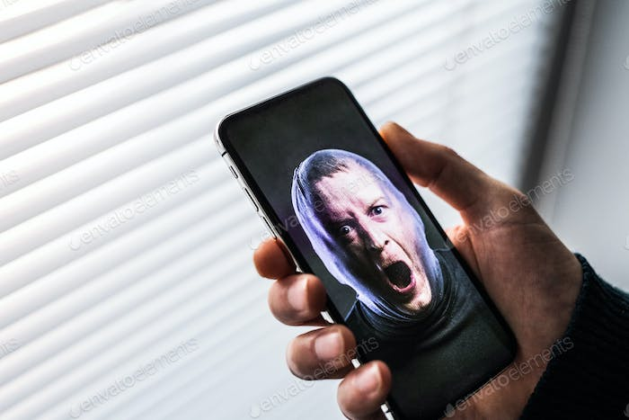 A smartphone using face ID recognition system.