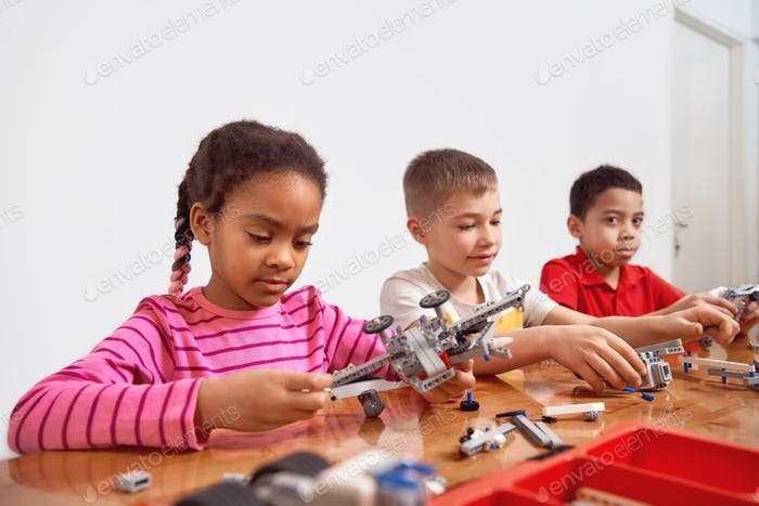 Kids using building kit to create toys