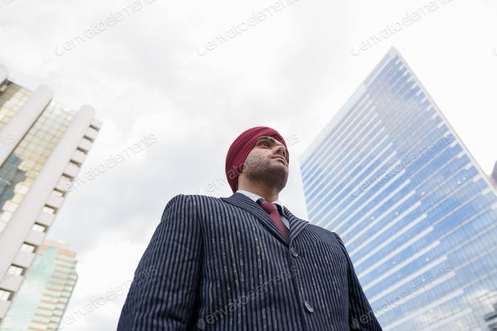 Portrait of Indian businessman with turban outdoors in city