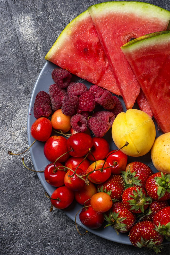 Different summer fruits and berries