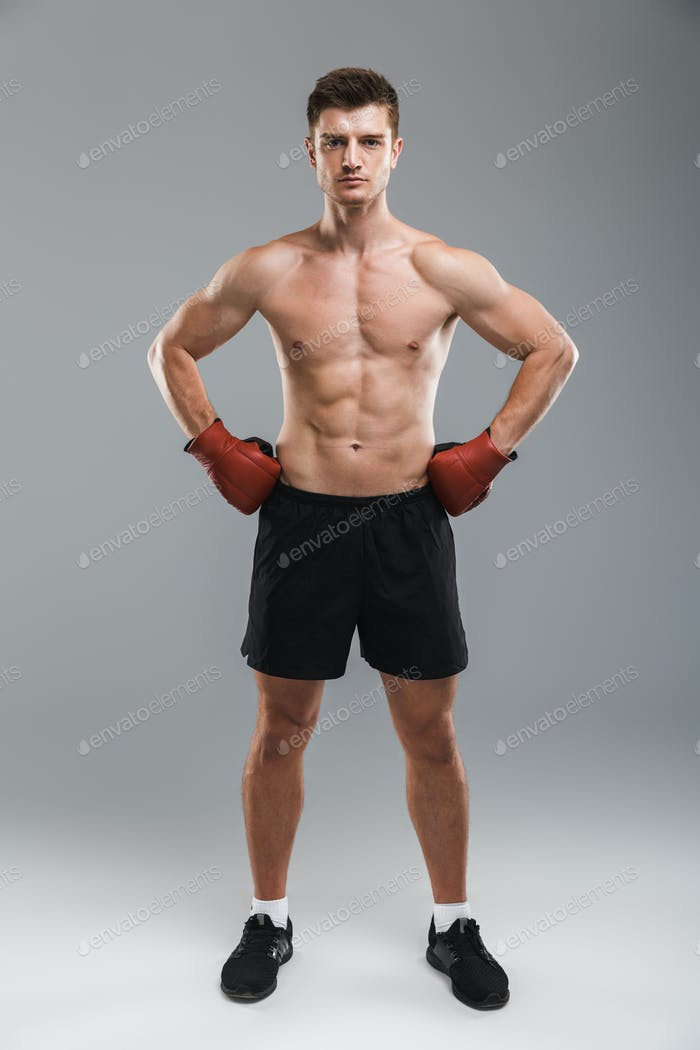 Full length portrait of a strong shirtless sportsman