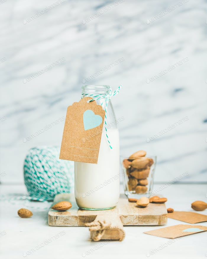 Fresh vegetarian dairy-free almond milk with craft paper label