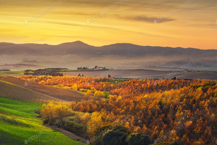 Autumn, panorama in Tuscany, rolling hills, woods and fields on