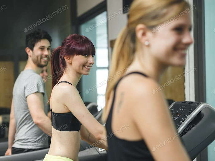 friends on a treadmill practiciting