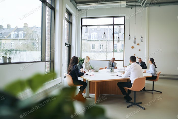 Smiling group of diverse businesspeople having a boardroom meeting together