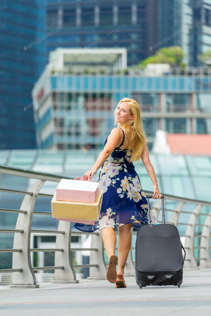 Happy shopper with shopping bags in SIngapore