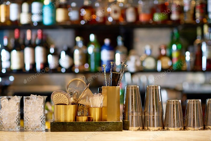 shakers, glasses, stirrers and strainers at bar