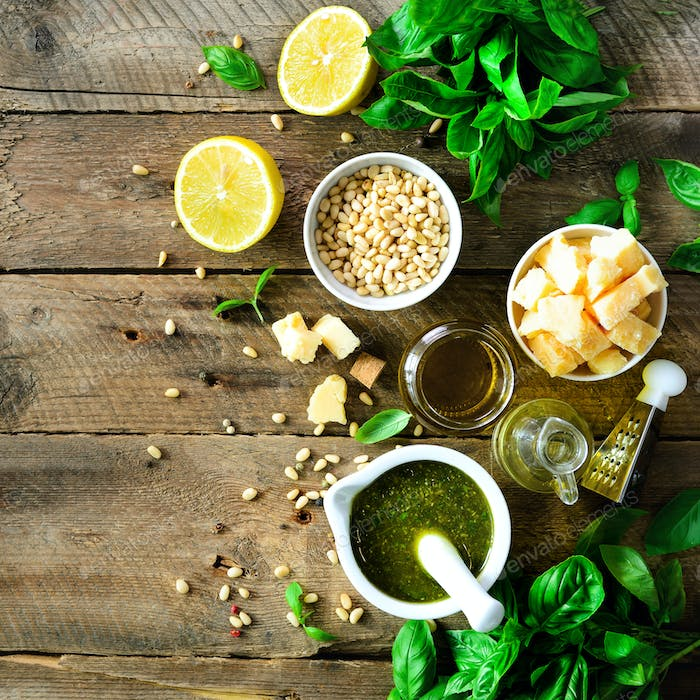 Ingredients for homemade pesto - basil, lemon, parmesan, pine nuts, garlic, olive oil and salt on