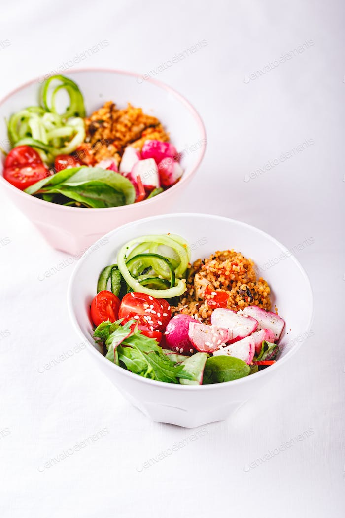 Fresh salad with couscous, tomatoes, cucumber, radish and chard.