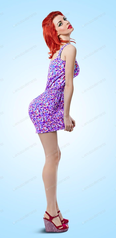 Fashion beauty redhead woman in mini dress. Pinup