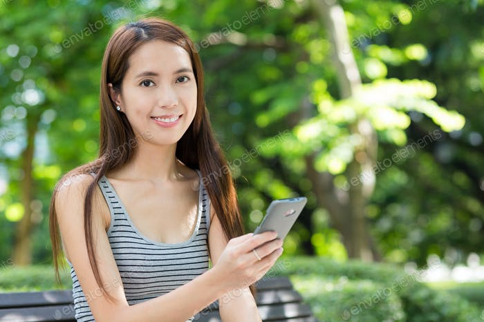 Young woman use of cellphone at outdoor