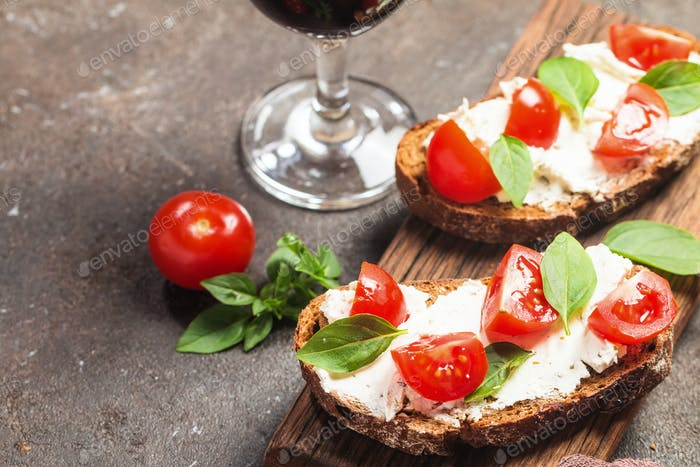Crostini appetizers with cherry tomatoes