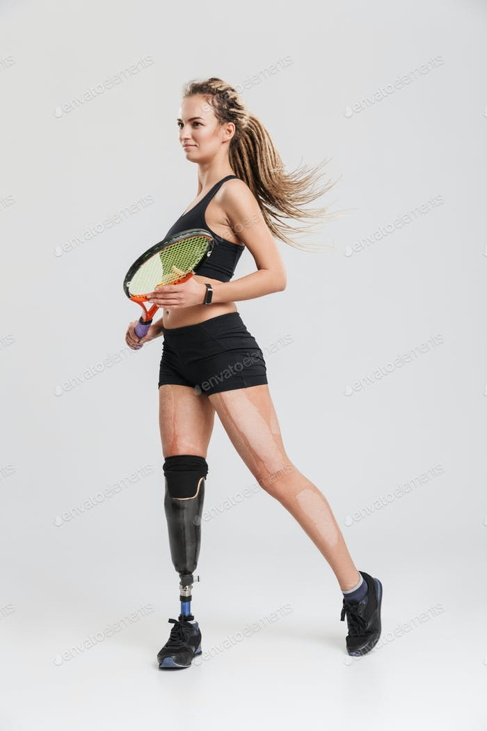 Strong young disabled sportswoman tennis player